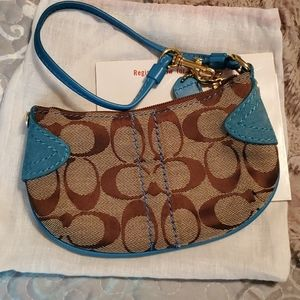Brown and turquoise Signature Coach Wristlet